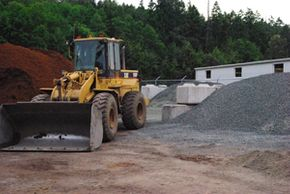 bulldozer near gravel pile
